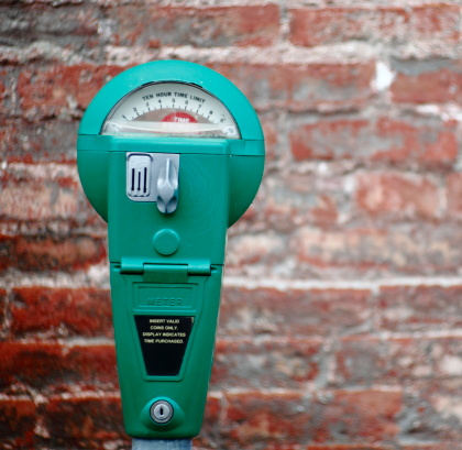 Parking Meter「A bright green parking meter on a brick background」:スマホ壁紙(16)