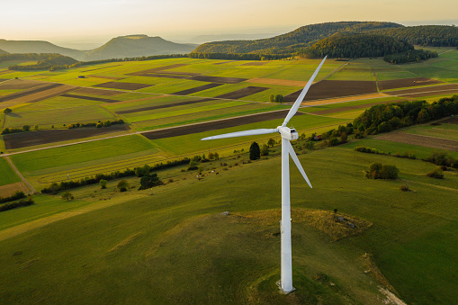 Drone Point of View「Alternative Energy Wind Turbine in Beautiful Green Landscape at Sunset」:スマホ壁紙(12)