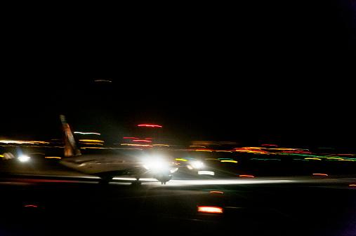Kennedy Airport「Aircraft taking off at airport at night」:スマホ壁紙(4)