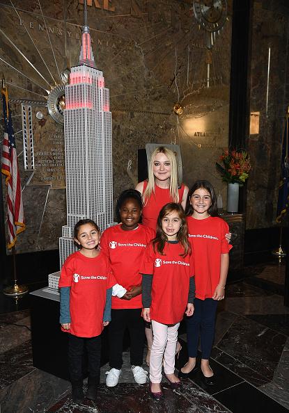 Empire State Building「Dakota Fanning Lights The Empire State Building In Honor Of International Day Of The Girl」:写真・画像(10)[壁紙.com]