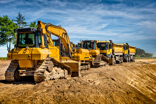 Construction Vehicle「Row of road construction machinery on the construction of highway, Poland」:スマホ壁紙(8)