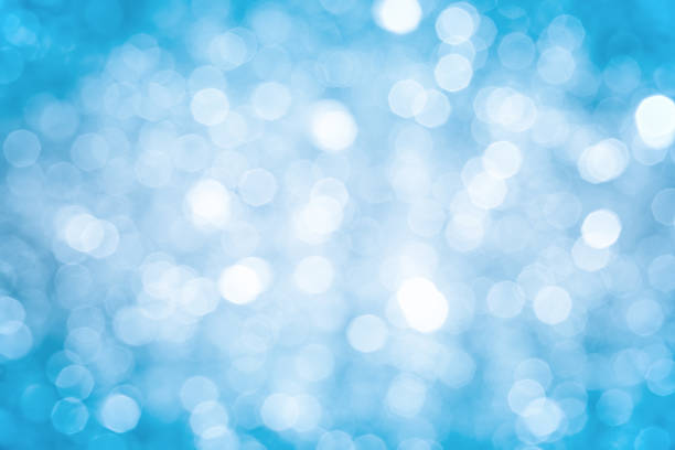 Blurred blue sparkles background with darker corners and bright center:スマホ壁紙(壁紙.com)