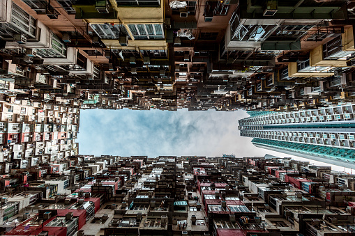 Unrecognizable Person「Hong Kong, Quarry Bay, apartment blocks contrasting with modern skyscraper」:スマホ壁紙(9)