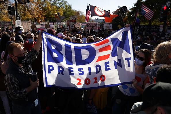 Winning「Supporters Of Joe Biden Celebrate Across The Country, After Major Networks Project Him Winning The Presidency」:写真・画像(7)[壁紙.com]