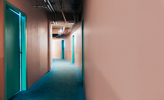Hostel「Teal doors in long curved alley with coral walls」:スマホ壁紙(15)