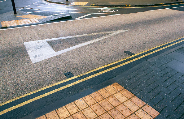 Road Marking「Coloured asphalt applied on road crossing with feature for blind pedestrians England, UK」:写真・画像(3)[壁紙.com]