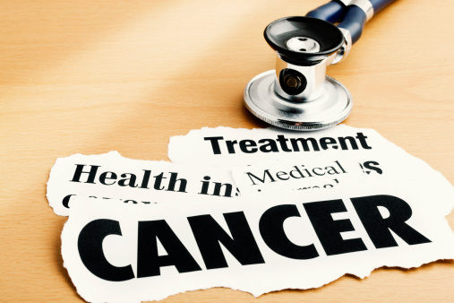 Oncology「Cancer headlines alongside stethoscope on desk」:スマホ壁紙(5)