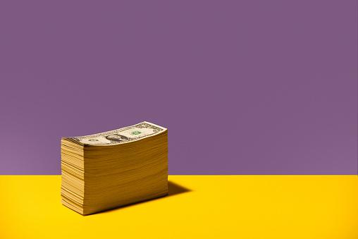 Male Likeness「Stack of US $1 bills sitting on yellow background」:スマホ壁紙(16)