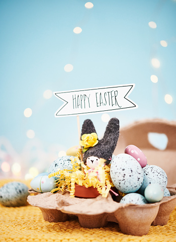 Easter Bunny「Handmade bunny in egg carton with yellow Easter eggs and holiday greeting」:スマホ壁紙(4)