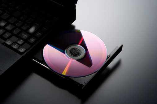 DVD「Inserting a CD into a laptop computer with copy space」:スマホ壁紙(10)