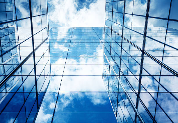 Blue Sky and Clouds Reflected in Modern Glass Architecture:スマホ壁紙(壁紙.com)