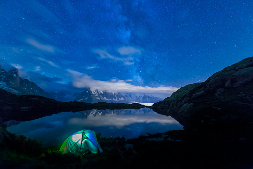 星空「France, Mont Blanc, Lake Cheserys, lit tent on the shore of the lake by night with Milky way and Mount Blanc reflected in the lake」:スマホ壁紙(0)