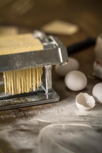 Animal Egg「Fresh pasta coming out of pasta machine, close up」:スマホ壁紙(18)