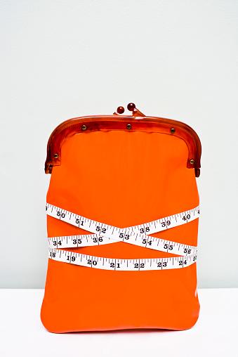 Money to Burn「Wallet wrapped in tape measure showing a financial diet」:スマホ壁紙(7)