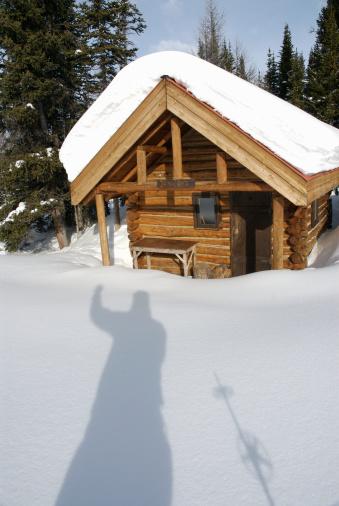 Mt Assiniboine「Shadow of skier over snow outside log cabin」:スマホ壁紙(14)
