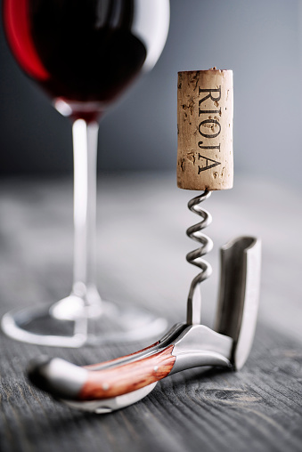 Corkscrew「Glass of red wine, corkscrew and wine cork with the word 'Rioja'」:スマホ壁紙(0)