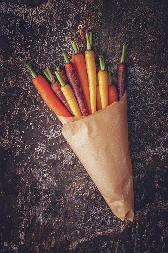 Vegetarian Food「Organic Colored Carrots on Rustic Background」:スマホ壁紙(3)