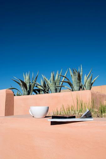 Morocco「Teacup, magazine, mobile phone on roof terrace」:スマホ壁紙(16)