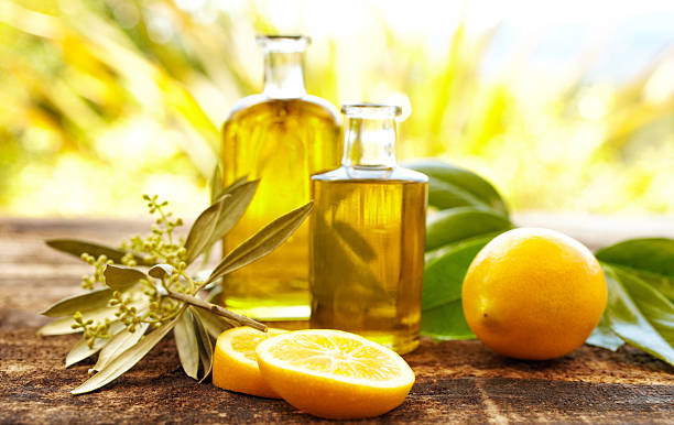 Massage oil bottles with lemons and olive branch:スマホ壁紙(壁紙.com)