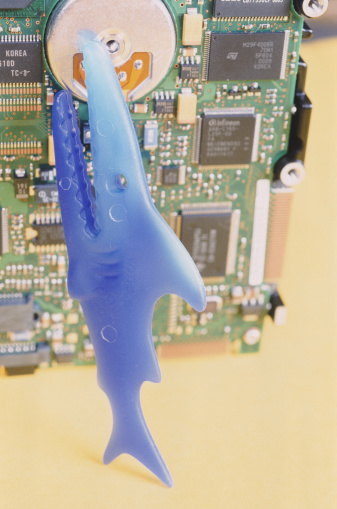Mother Board「Computer hard drive with toy shark, close-up」:スマホ壁紙(19)