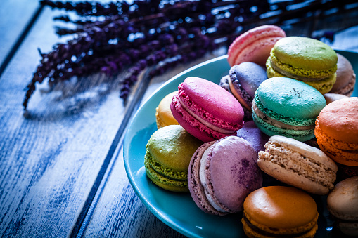 France「Multi colored macaroons in a blue plate shot on blue table」:スマホ壁紙(5)
