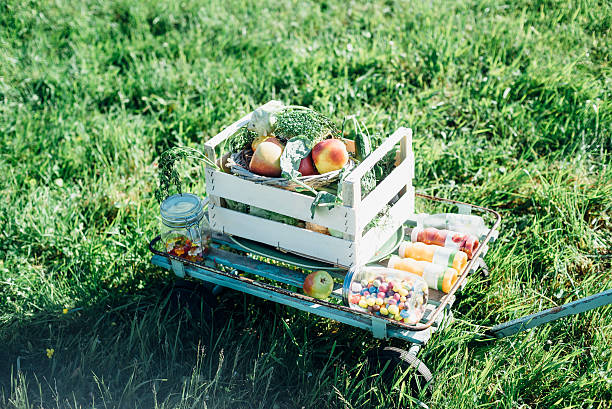 Crate with apples andsweets on cart in meadow:スマホ壁紙(壁紙.com)