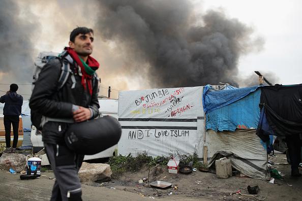 Calais「Migrants Leave The Jungle Refugee Camp In Calais」:写真・画像(9)[壁紙.com]