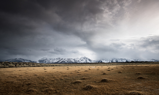 Wilderness「Open Field Shows Evidence of Geothermal Activity, Snow-capped Mountains in Distance, Stormy Sky」:スマホ壁紙(9)