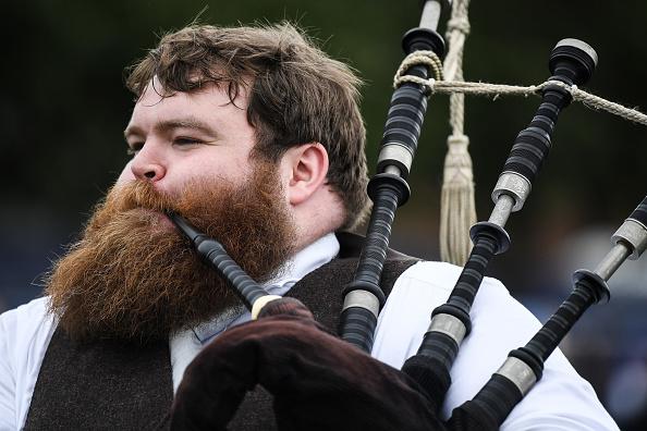 ヒューマンインタレスト「Pipe Bands March Through Glasgow To Mark The Start Of The World Pipe Band Championships」:写真・画像(16)[壁紙.com]