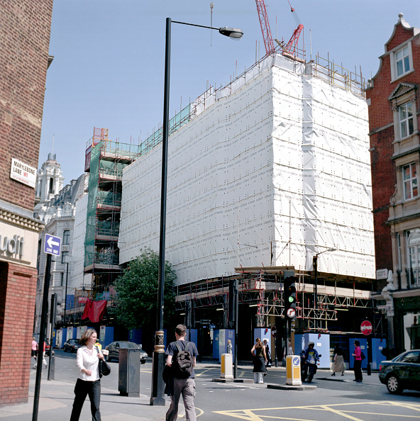 Construction Equipment「Building covered with a safety scaffolding Net」:写真・画像(5)[壁紙.com]