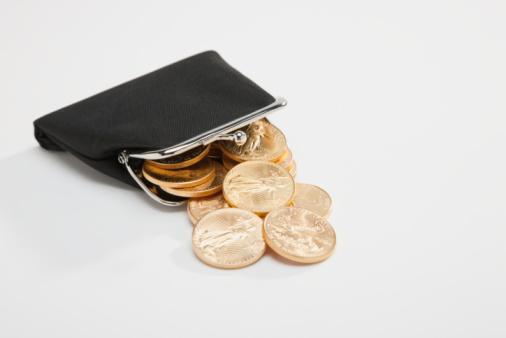 金運「Gold coins spilling out of change purse」:スマホ壁紙(12)