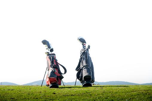 Taking a Shot - Sport「Two Golf Bags on Meadow」:スマホ壁紙(2)