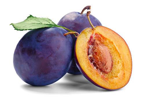 Plum「Two whole and one sliced plum with flesh and pit showing 」:スマホ壁紙(1)
