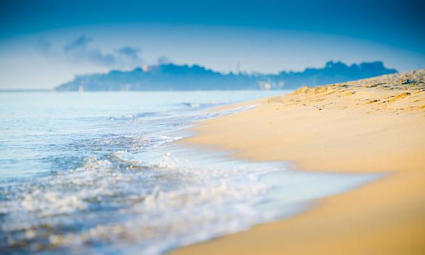 Beautiful tropical sand beach against the blue sky.:スマホ壁紙(壁紙.com)