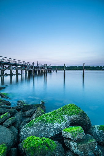 Black And White Instant Print「Vibrant colors light up the sky just after sunset over a long fishing pier」:スマホ壁紙(12)