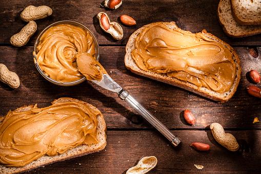 Sandwich「Peanut butter on toast shot on rustic wooden table」:スマホ壁紙(15)