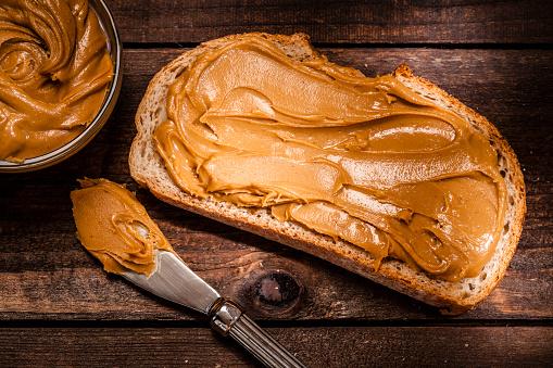 Nut - Food「Peanut butter on bread slice shot on rustic wooden table」:スマホ壁紙(14)