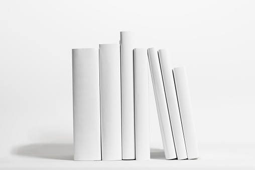 Standing「Seven white books in front of white background」:スマホ壁紙(9)