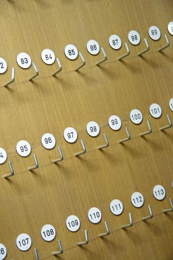Unrecognizable Person「Hooks for keys in hotel」:スマホ壁紙(1)
