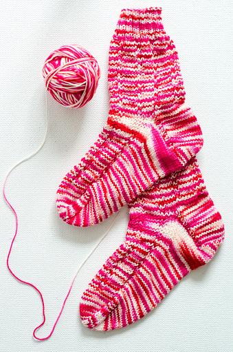 Knitted「Hand-knitted pair of woolen socks」:スマホ壁紙(8)