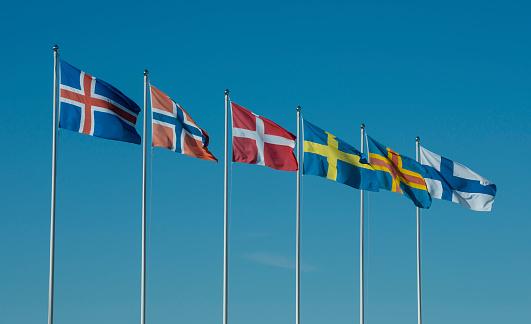 Finland「Row of Scandinavian national flags in front of blue sky」:スマホ壁紙(12)