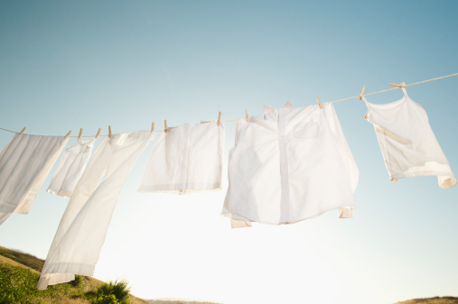 Washing「USA, California, Ladera Ranch, Laundry hanging on clothesline against blue sky」:スマホ壁紙(2)