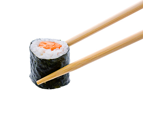 Asian Food「A sushi roll with salmon being held by wooden chopsticks」:スマホ壁紙(13)
