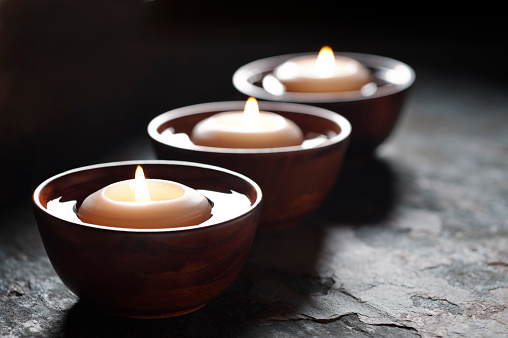 Candle「Three lit candles floating in wooden bowls filled with water」:スマホ壁紙(7)