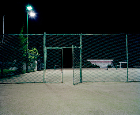 Accessibility「Open gate surrounding two tennis courts, night」:スマホ壁紙(12)