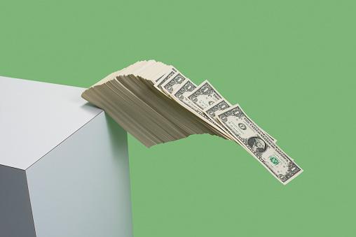 Green Background「Money falling over the edge」:スマホ壁紙(0)