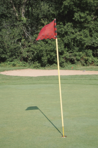 Sand Trap「Flag stick in hole on golf course」:スマホ壁紙(1)
