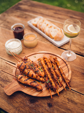 Char-Grilled「Chicken skewers and bacon twists on a wooden board」:スマホ壁紙(19)
