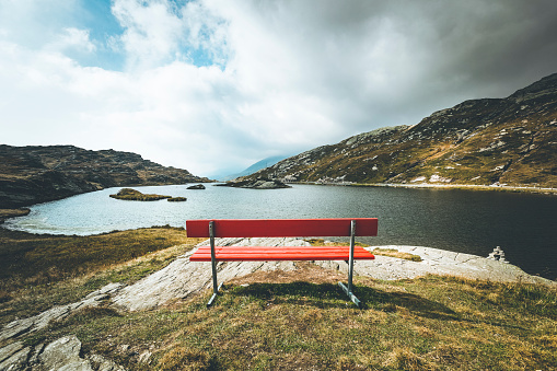 Graubunden Canton「red bench with a view, mountain lake san bernardino, switzerland」:スマホ壁紙(5)