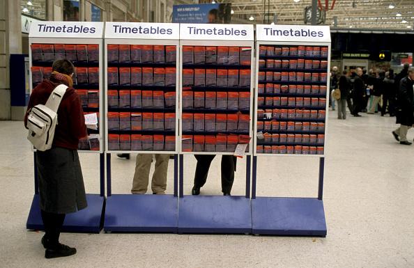 Rack「A traveller checks timetable information at Waterloo station」:写真・画像(6)[壁紙.com]